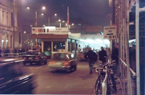 "The famous ""Checkpoint Charlie"" at the Berlin Wall, as seen in spy and historical movies"